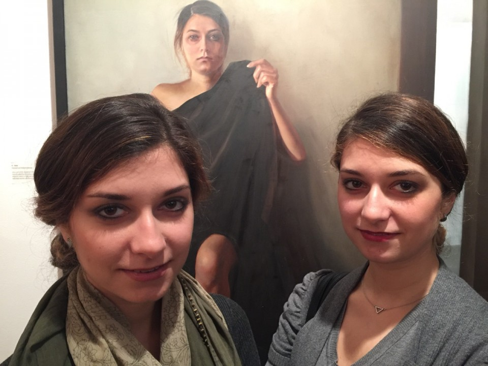 "Artists Farzaneh and Bahareh Sararani in front of their painting ""Alone"""